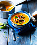 Pumpkin soup with sweetcorn salsa in a bowl