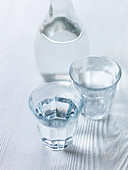 Water glasses on white wood