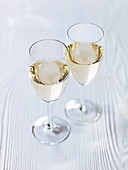 White wine on white wooden surface