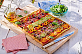 Rectangular vegetable pizza on a cutting board