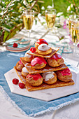 Mille Feuille with cream puffs and a raspberry glaze