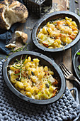 Individual dishes of Mac and cheese with butternut squash and sage