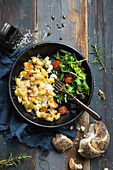 Mac and cheese baked with roasted butternut squash and sage