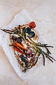 Naan Flatbread with roasted onions, leeks, radish and carrots