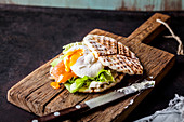 Waffle sandwich with salmon and a poached egg
