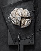 Homemade bread on a black linen cloth