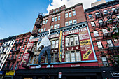 A photo installation of 'JR' on the facade of the former fabric shop 'Beckenstein', New York City, USA