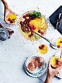 Peach, raspberry, Earl Grey and gin punch bowl