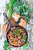 Beef stew with carrots and peas