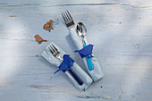 Handmade paper napkin rings with blue bird motifs