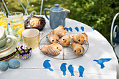 Easter breakfast in garden with pastries and handmade table decorations
