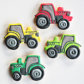 Colorfully decorated cookies in the shape of tractors