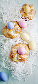 Easter nests with coloured eggs