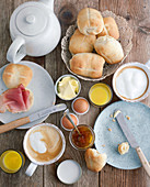 Homemade breakfast rolls on a table laid for breakfast