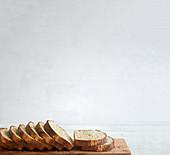 Spelt bread, sliced on a wooden board