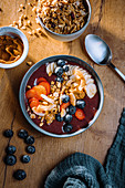 Vegan acai bowl with coconut chips and fresh fruit