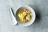 Thai fish soup with mango