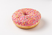 Donut with pink icing and sprinkles