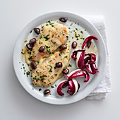 Chicken schnitzel with asiago and olives