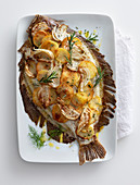 Turbot with a fennel and potato crust and rosemary