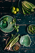 Green Veggies on textured green wooden surface
