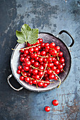 Fresh red currants in a vintage colander