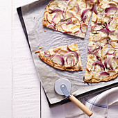 Tarte flambée with apple, onions and goat's cheese