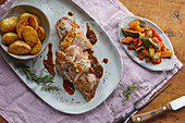 Roast lamb with fried potatoes and vegetables