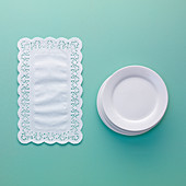 Doilies and a stack of plates