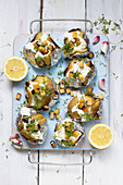 Vegan baked potatoes with soy yogurt and smoked tofu