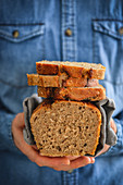 Homemade wheat bread in a man's hands