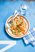 Spaghetti with carrot strips and chilli