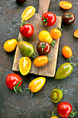 Colourful tomatoes on a rustic surface