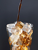 Iced coffee - Pouring coffee on ice cubes