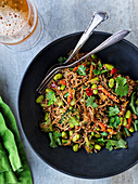 Asian noodles with vegetables and edamame