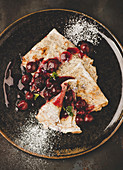Poppyseed pancakes with cherry compote