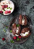 Chocolate ice cream sandwich with raspberries