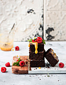 Brownies with caramel sauce and raspberries