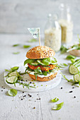 Vegetable bulgur wheat patty in a multigrain roll with cucumber and rocket