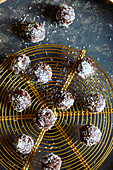 Gluten-free date and chocolate balls with grated coconut