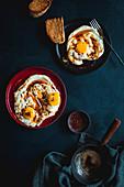 Turkish eggs - Fried eggs on garlic yoghurt with Aleppo pepper