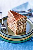 A piece of tiramisu pancake cake