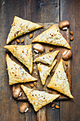 Vegan puff pastry pockets with mushroom filling and almonds