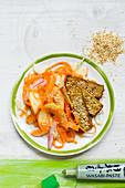 Vegan carrot and apple salad with sesame tofu