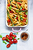 Vegan penne with asparagus and red pesto