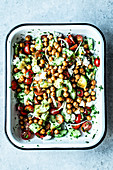 Chickpea salad with feta cheese, cucumber and tomatoes