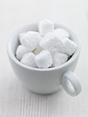 Cup of white sugar lumps