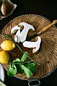 Mushroom and lemons on chopping board