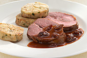 Roe deer sauerbraten with sweet and sour sauce and napkin dumplings