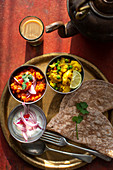 Indian thali with yogurt and chapati